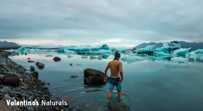 Man going into a lake to practice the Wim Hof Method